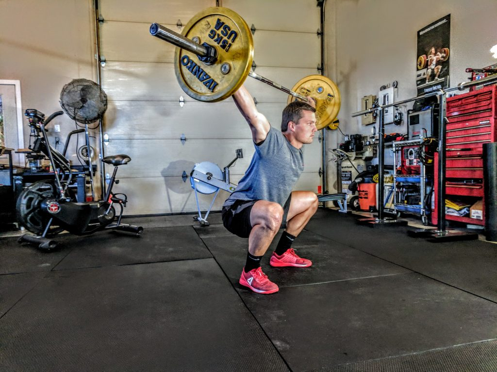 Man Performing a Squat Snatch